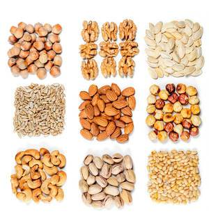 Top view, set of different types of nuts and seeds on a white background (Flip 2020)