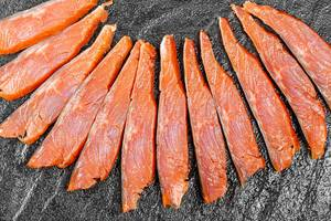 Top view sliced pieces of smoked red fish fillet (Flip 2020)