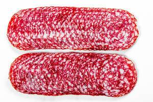 Top view sliced smoked salami on white background (Flip 2019)