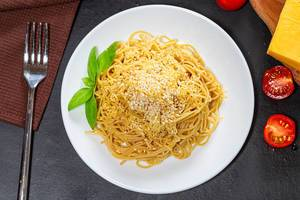 Top view spaghetti with cheese, sesame seeds and Basil leaves on a black background (Flip 2019)