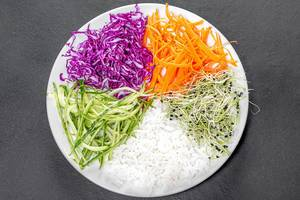 Top view vegetarian lunch with rice and vegetables on black background (Flip 2019)