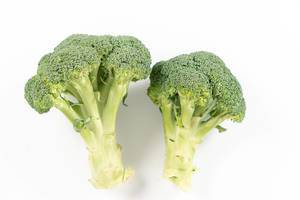 Topv view of Fresh Broccoli above white background