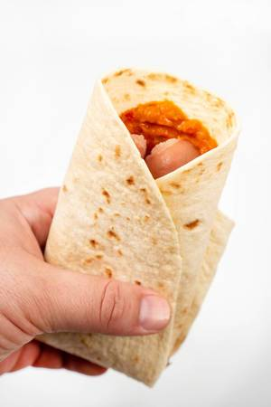 Tortilla-with-Sausages-in-the-hand-above-white-background.jpg