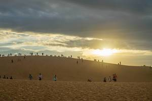 Tourists watching the Sunset in Red Sand Dunes in Mui Ne, Vietnam  Flip 2019
