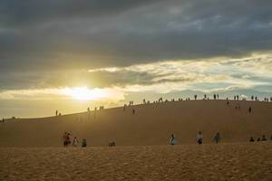 Tourists watching the Sunset in Red Sand Dunes in Mui Ne, Vietnam