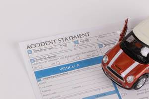 Toy car on accident statement report