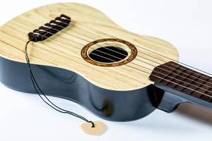 Toy guitar with strings