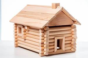 Toy house on white wooden background (Flip 2019)