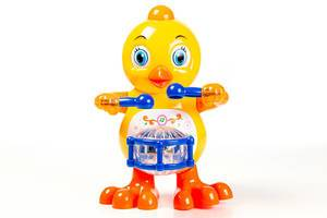 Toy-yellow-chicken-with-a-drum-on-a-white-background.jpg