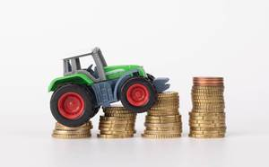 Tractor on coin stacks