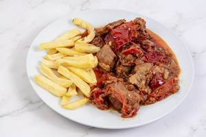 Traditinal meal Muckalica with Pork Meat and French Fries