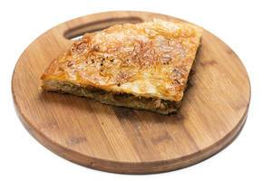 Traditional balkan burek pie with meat isolated over white background