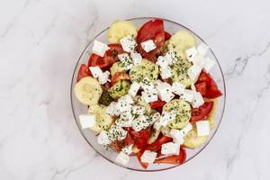 Traditional Balkan salad with Tomato Cheese Cucumber and Onions