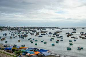 Traditional Fishing Boats at Cloudy Weather in the Harbor of Mui Ne, Vietnam