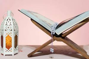 Traditional middle-eastern lantern and Islamic Holy book Koran. Islam, religion, Eid concepts