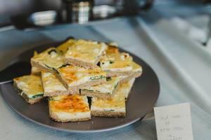 Traditional Tarte Flambée With Crème Fraiche, Cheese, Onion