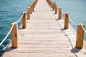 Travel Photo of Wooden Footbridge to the Sea in the Summer