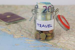 Travel savings: money in a jar for a trip around the world and journeys in foreign countries