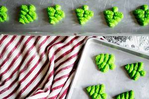 Tree shaped cookies in baking sheets