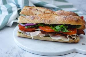 Turkey Sandwich with Salad and Tomato
