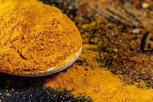 Turmeric powder on dark background