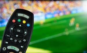 Tv remote control with football on the screen