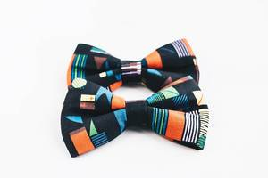 Two colorful bow ties on white background