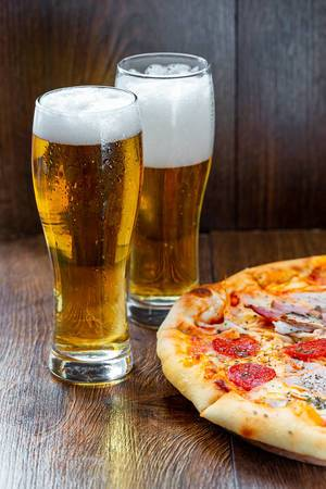 Two glasses of cold beer with pizza (Flip 2019) (Flip 2019)