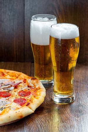 Two-glasses-of-cold-beer-with-pizza.jpg