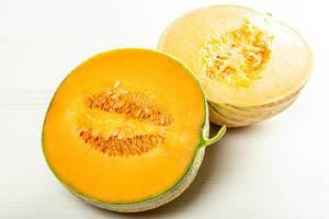 Two halves of ripe orange melon with seeds inside (Flip 2019)