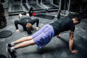 Two men exercising at the gym