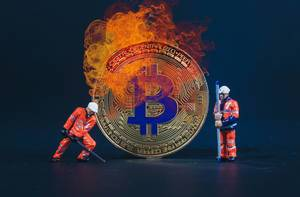 Two miners with Bitcoin in flames