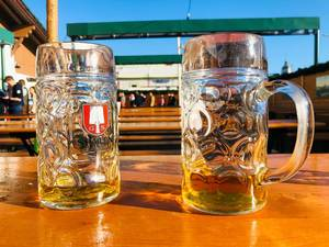 Two not completely drunk-up beer as a typical gesture at the Oktoberfest