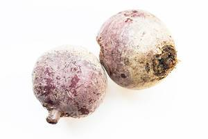 Two raw beetroots on white background  Flip 2019