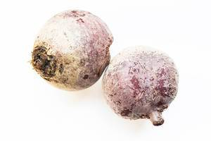 Two raw beetroots on white background