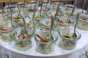 Tyrolean smoked sausage on apple and leek salad in small jars at the BarCamp in Bonn