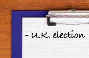 U.K. election text on clipboard