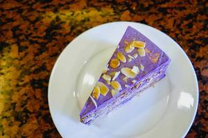 Ube cake with nuts on flat surface (Flip 2019)