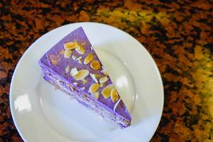 Ube cake with nuts on flat surface
