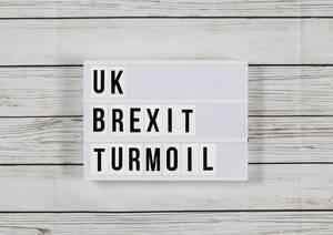 UK shares slip amid Brexit political turmoil