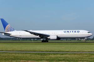 United Airlines taking off from runway, Amsterdam Schiphol Airport AMS
