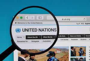 United Nations logo under magnifying glass