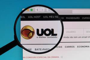 UOL logo under magnifying glass
