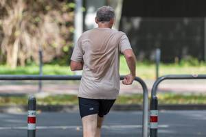 Urban sports: man doing jogging in the city