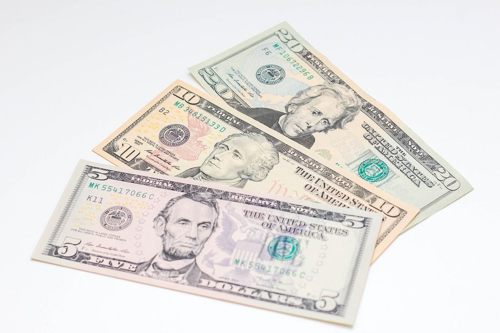 US Dollar on a white Background Close-Up