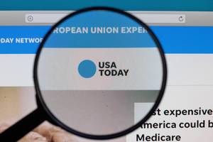USA Today logo under magnifying glass