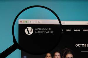 Vancouver Fashion Week logo on a computer screen with a magnifying glass