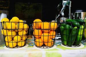 Various fruits inside metal baskets