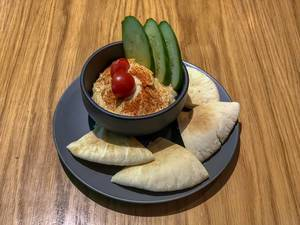 Veg hummus at Avocado Cafe: chickpeas, sesame paste, lemon juice, garlic, olive oil, spices, cucumbers, tomatoes, pita bread