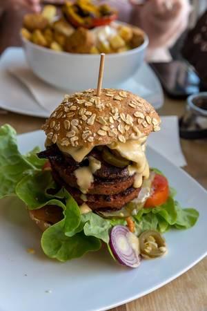 Vegan Beyond Meat Burger with fresh vegetables and Portobello mushroom bacon